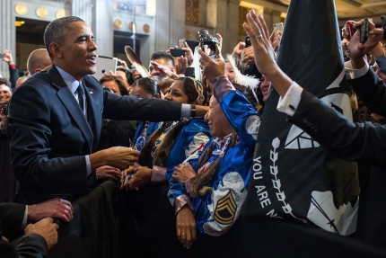 President Barack Obama greets audience members after remarks during the 2013 Tribal Nations Conference at the Department of the Interior in Washington, D.C