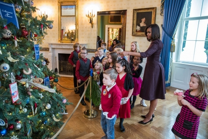 First Lady Michelle Obama and children of military families look at the White House Christmas tree
