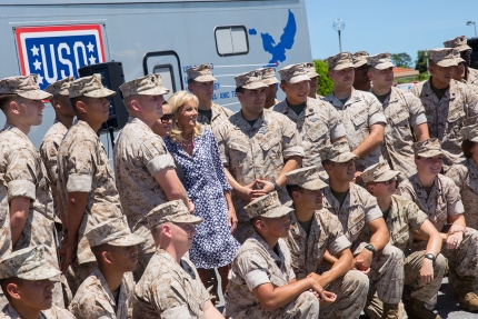 Dr. Jill Biden takes a photo with a group of Marines at Kadena Air Base