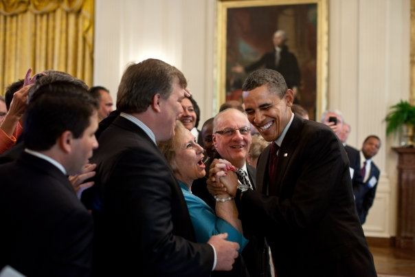 President Barack Obama greets guests during a reception for U.S. mayors