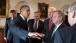 President Barack Obama talks with Senators