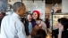 President Obama Looks At A Selfie With Restaurant Staff