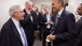 President Barack Obama talks with E.J. Dionne, Jr.