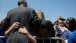 President Barack Obama hugs people at the National Peace Officers Memorial Service