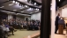 Audience Is Reflected In Glass As President Obama Speaks