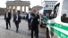 President Obama walks by the Brandenburg Gate in Berlin