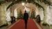 President Obama Walks Through The Ground Floor Corridor