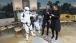 President Barack Obama and First Lady Michelle Obama dance with a Storm Trooper and R2-D2