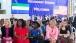 Dr. Jill Biden, Second Lady Khadija Sam Sumana, and granddaughter Finnegan Biden watch performances