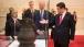 Vice President Joe Biden talks and Chinese President Xi Jinping look at artifacts