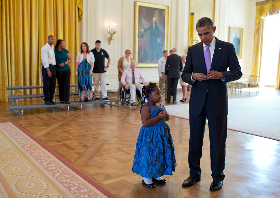 President Obama writes an excuse for five-year-old Alanah Poullard, who skipped school to visit the White House. September, 2013