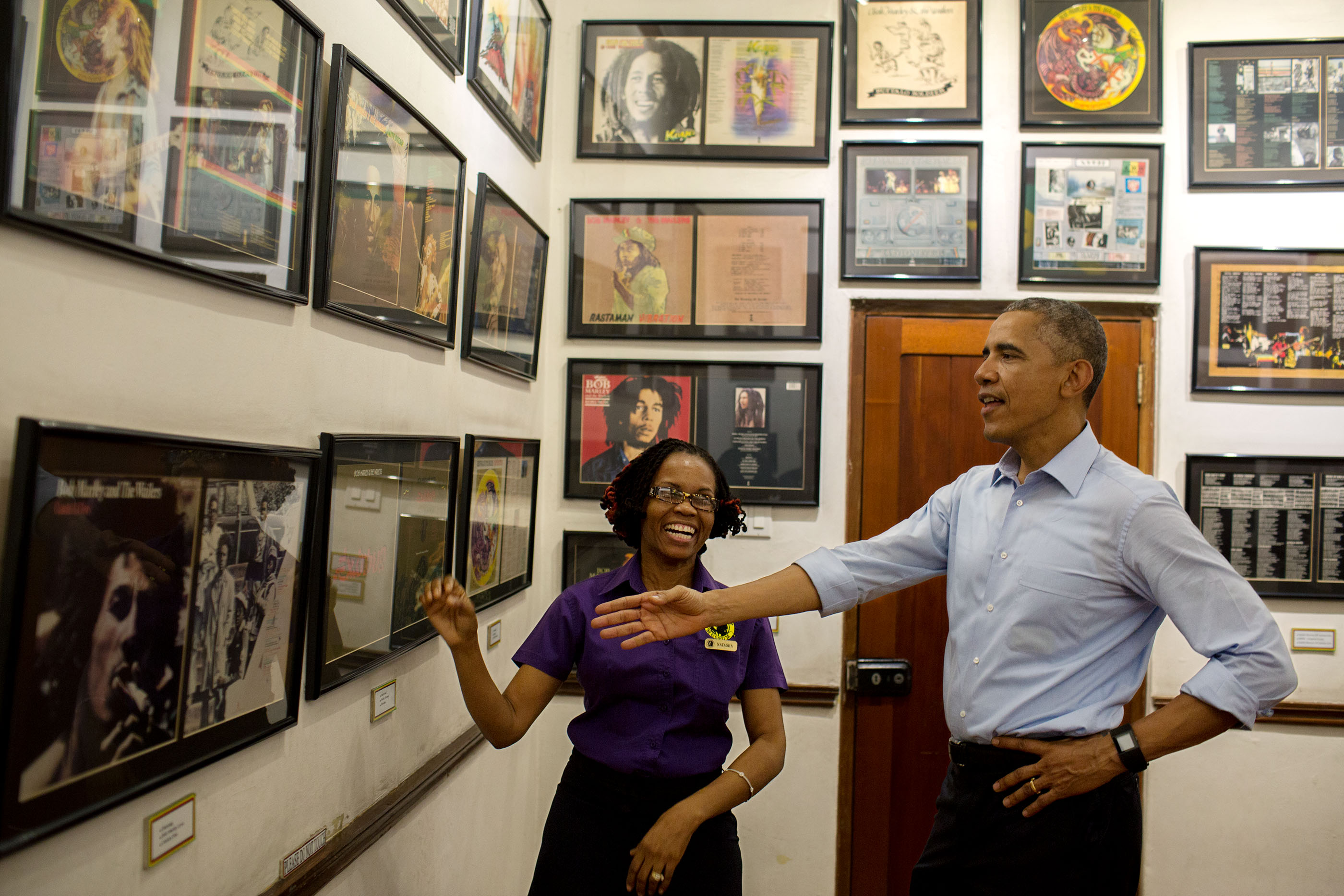 The President looks at memorabilia at the Bob Marley Museum during a tour with Natasha Clark.  (Official White House Photo by Pete Souza)