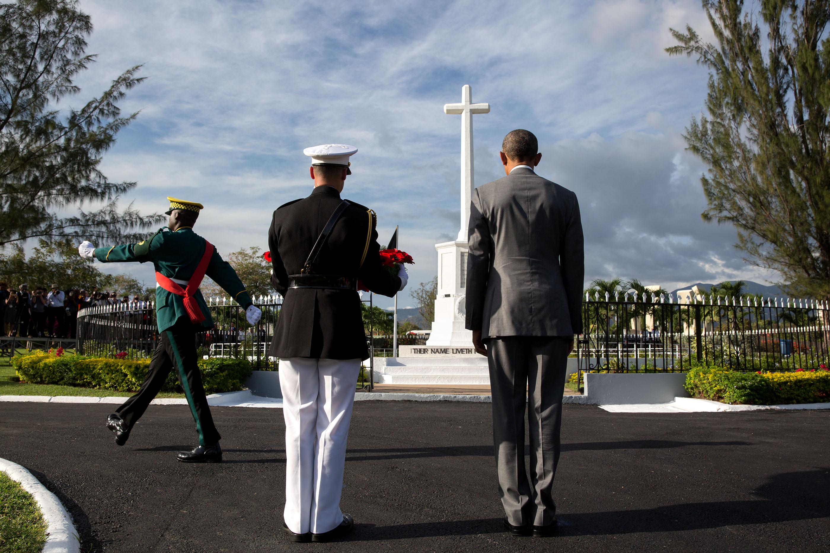 President Obama and Marine Corps military aide Steven Schreiber participate in a wreath laying ceremony at National Heroes Park in Kingston. (Official White House Photo by Pete Souza)