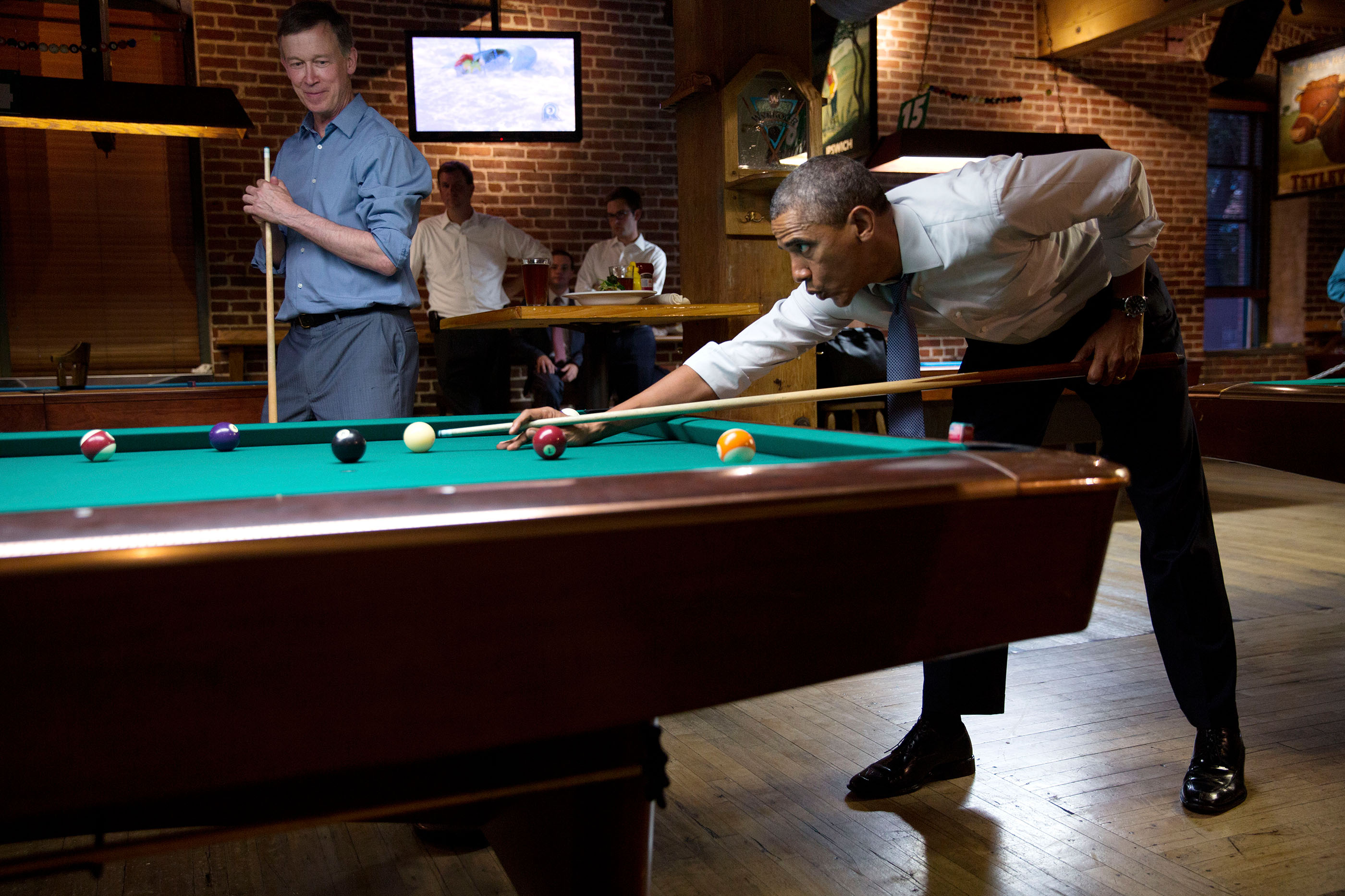 Colorado, July 8, 2014. Playing pool with Gov. John Hickenlooper in Denver. (Official White House Photo by Pete Souza)