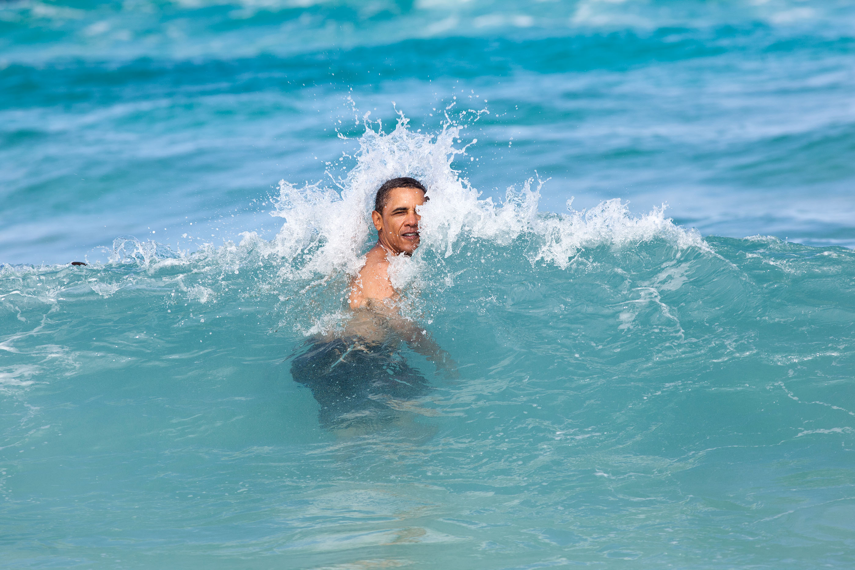 Hawaii, Jan. 1, 2012. Swimming at Pyramid Rock Beach in Kaneohe Bay. (Official White House Photo by Pete Souza)