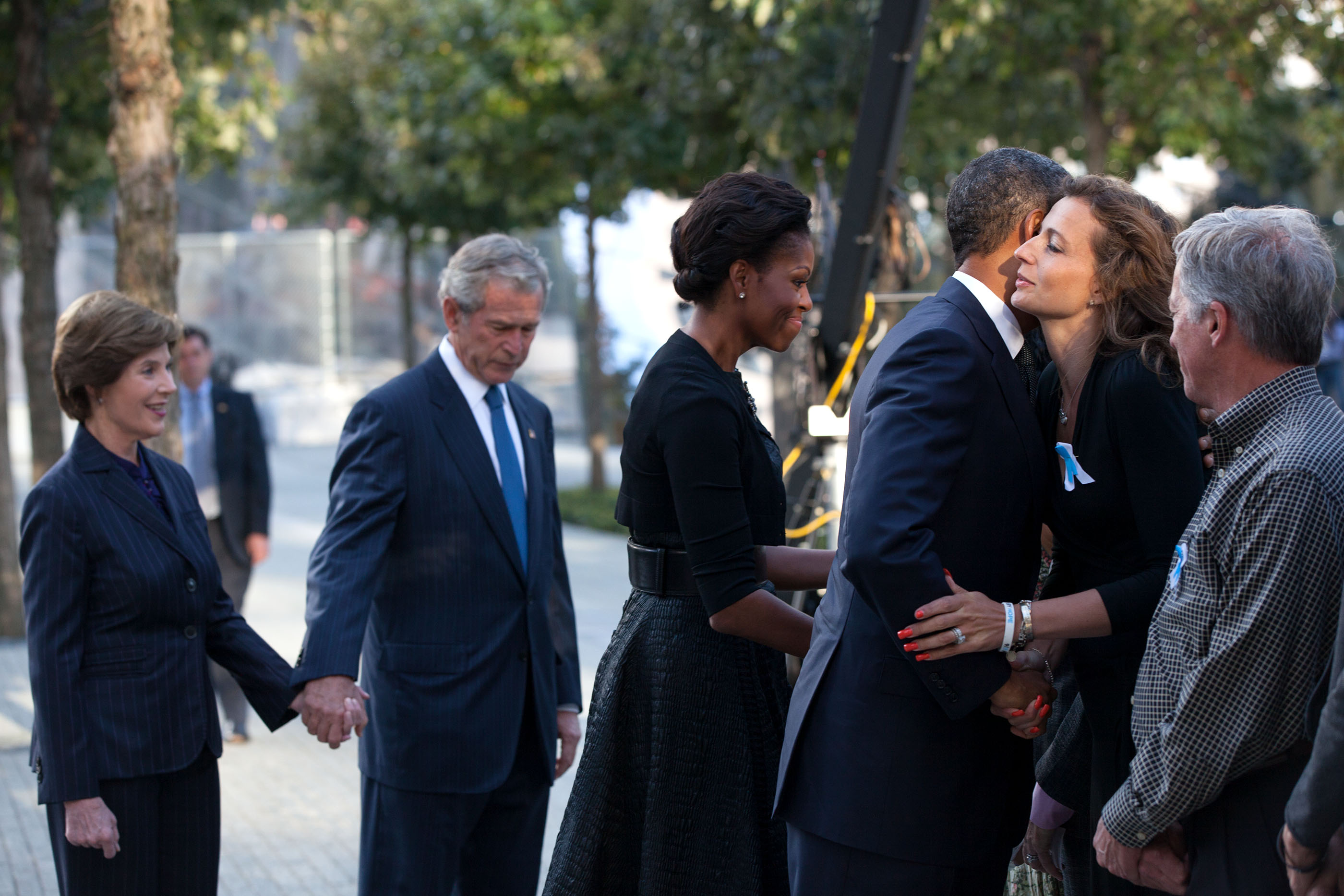 New York, Sept. 11, 2011. Greeting families, with former President and Mrs. Bush, prior to a commemoration ceremony on the tenth anniversary of the 9/11 terrorist attacksPresident and Mrs. Obama. (Official White House Photo by Pete Souza)