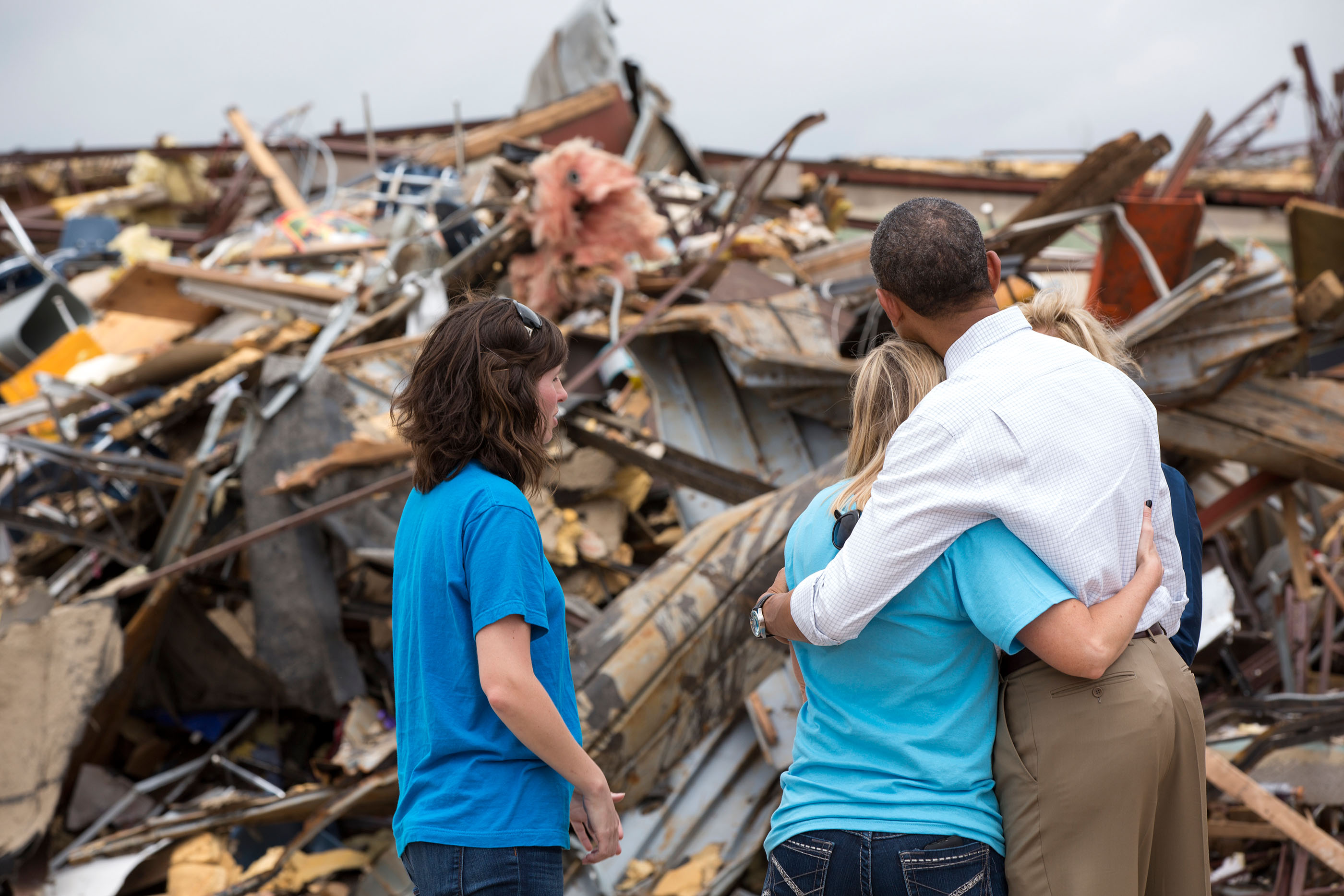 Oklahoma, May 26, 2013. Hugging Amy Simpson, principal of Plaza Towers Elementary School, while viewing the remains of the school following a devastating tornado in Moore. (Official White House Photo by Pete Souza)