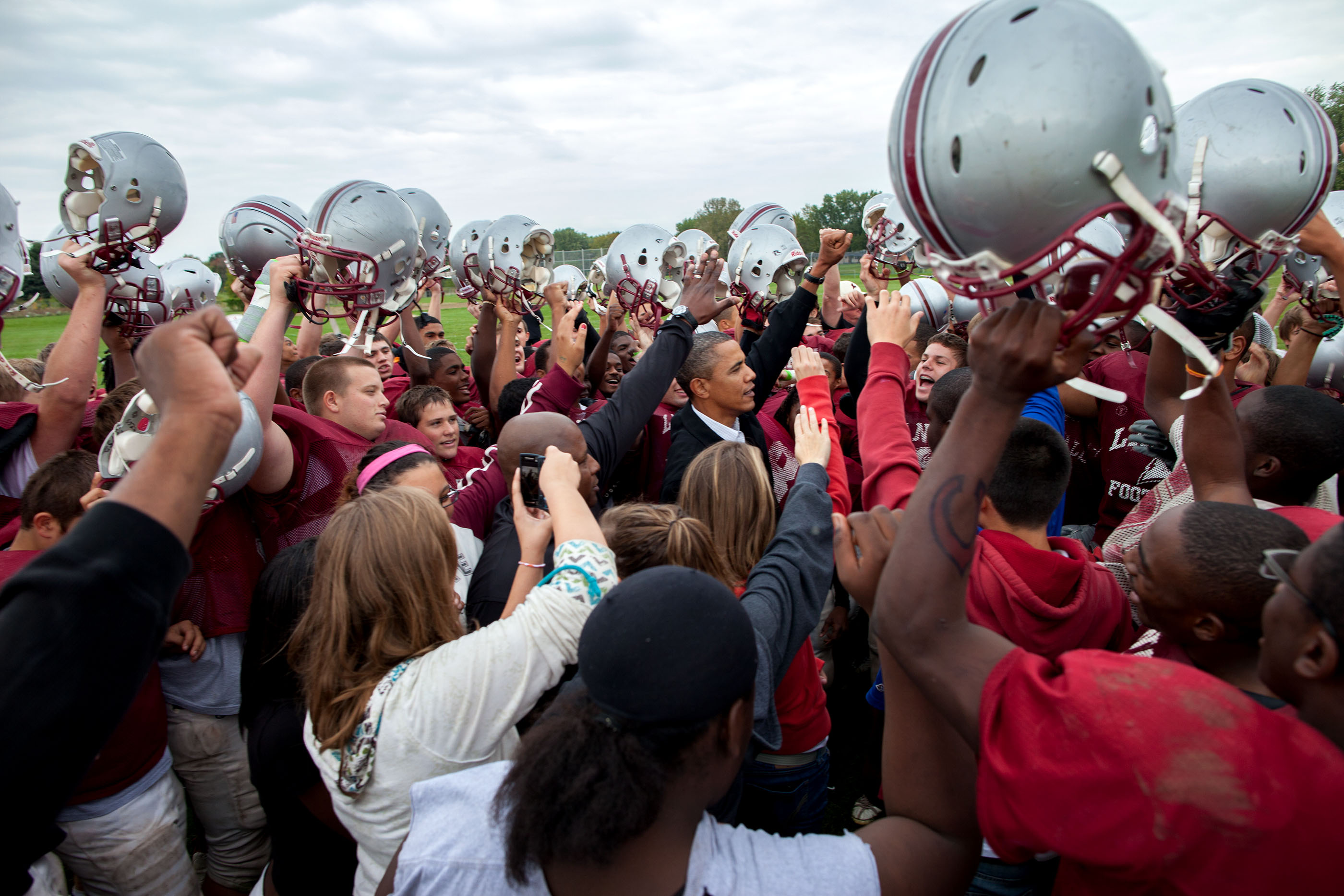 Wisconsin, Sept. 28, 2010. Cheering with the La Follette Lancers football team during their practice in Madison. (Official White House Photo by Pete Souza)