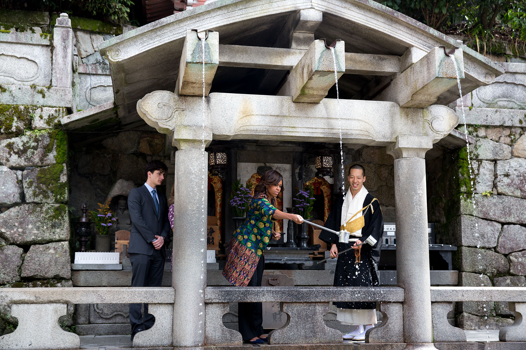The First Lady participates in the ritual of cleaning the hands and drinking from Otowa Waterfall. (Official White House Photo by Amanda Lucidon)