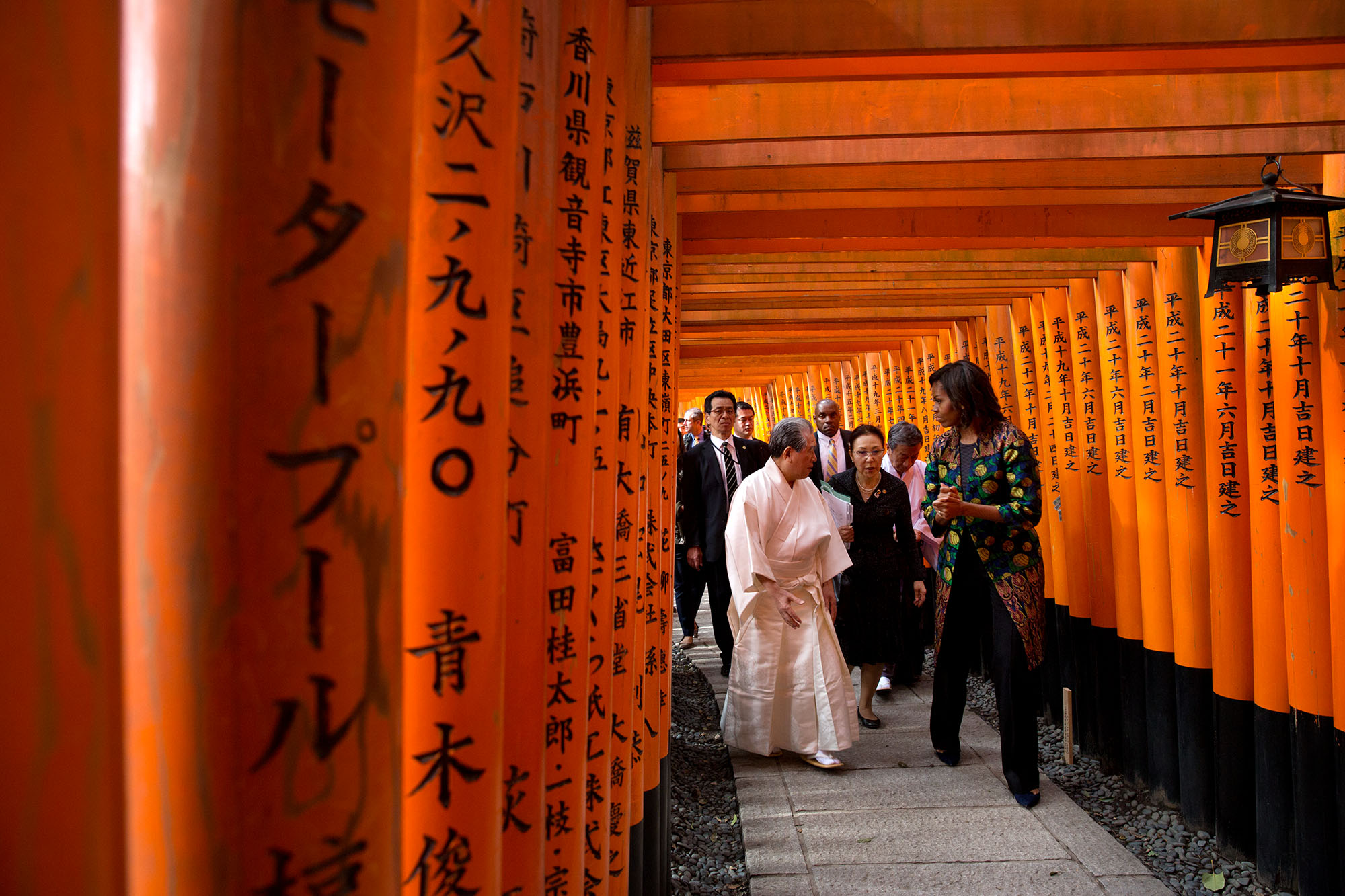 The First Lady is guided through the torri gates of the shrine. (Official White House Photo by Amanda Lucidon)