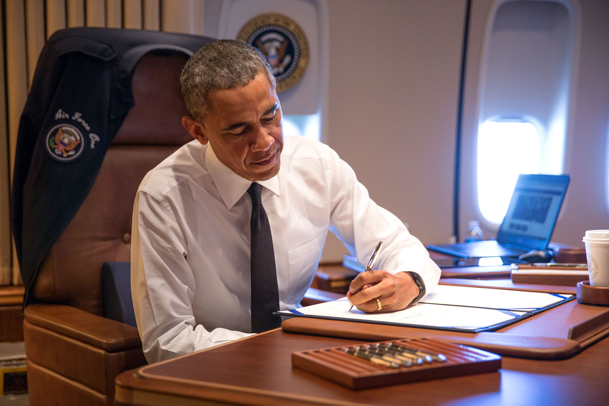 Aboard Air Force One en route to Alabama, President Obama signs H.R. 432 authorizing the Congressional Gold Medal to the