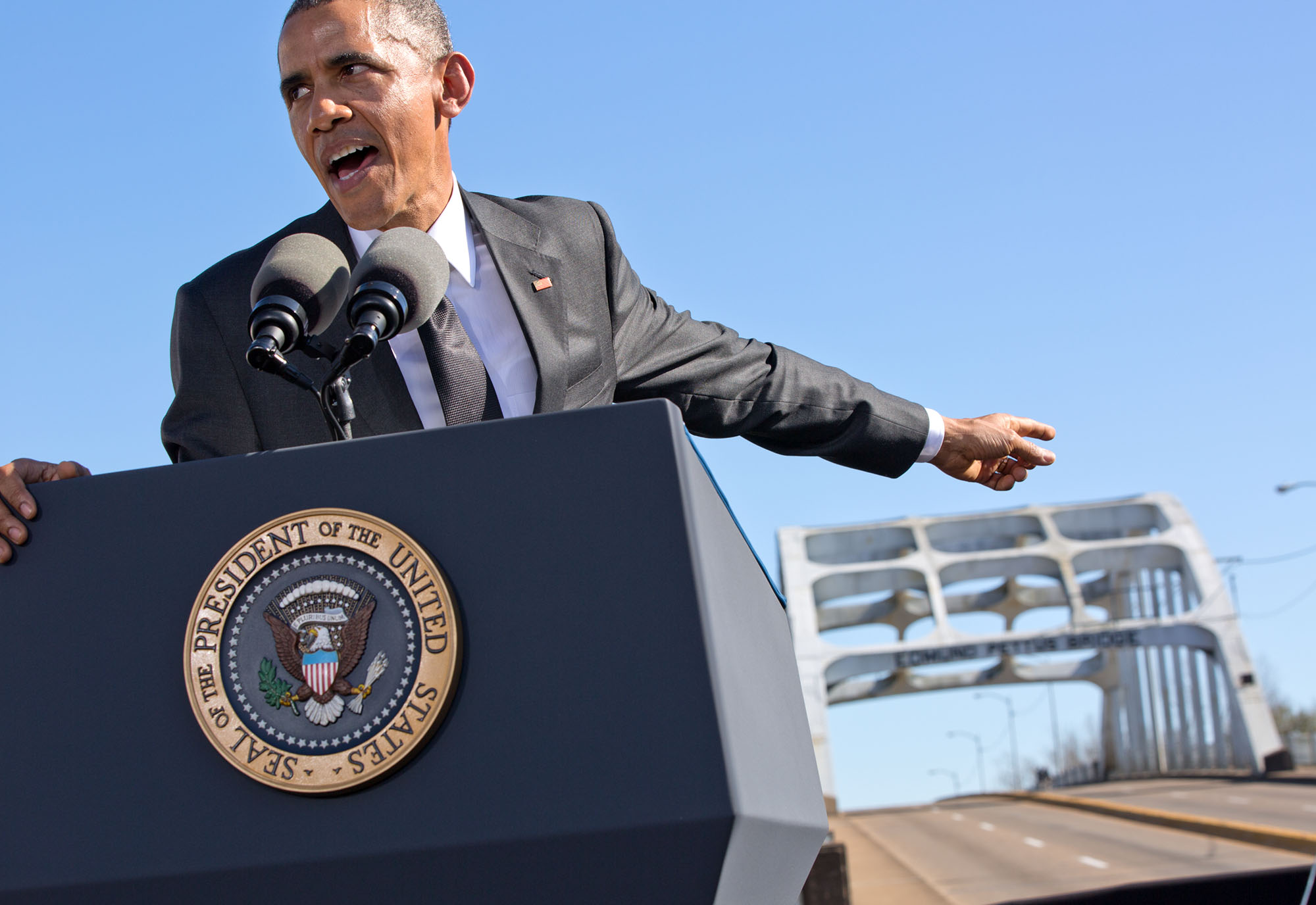The President points towards the bridge during his speech. (Official White House Photo by Pete Souza)