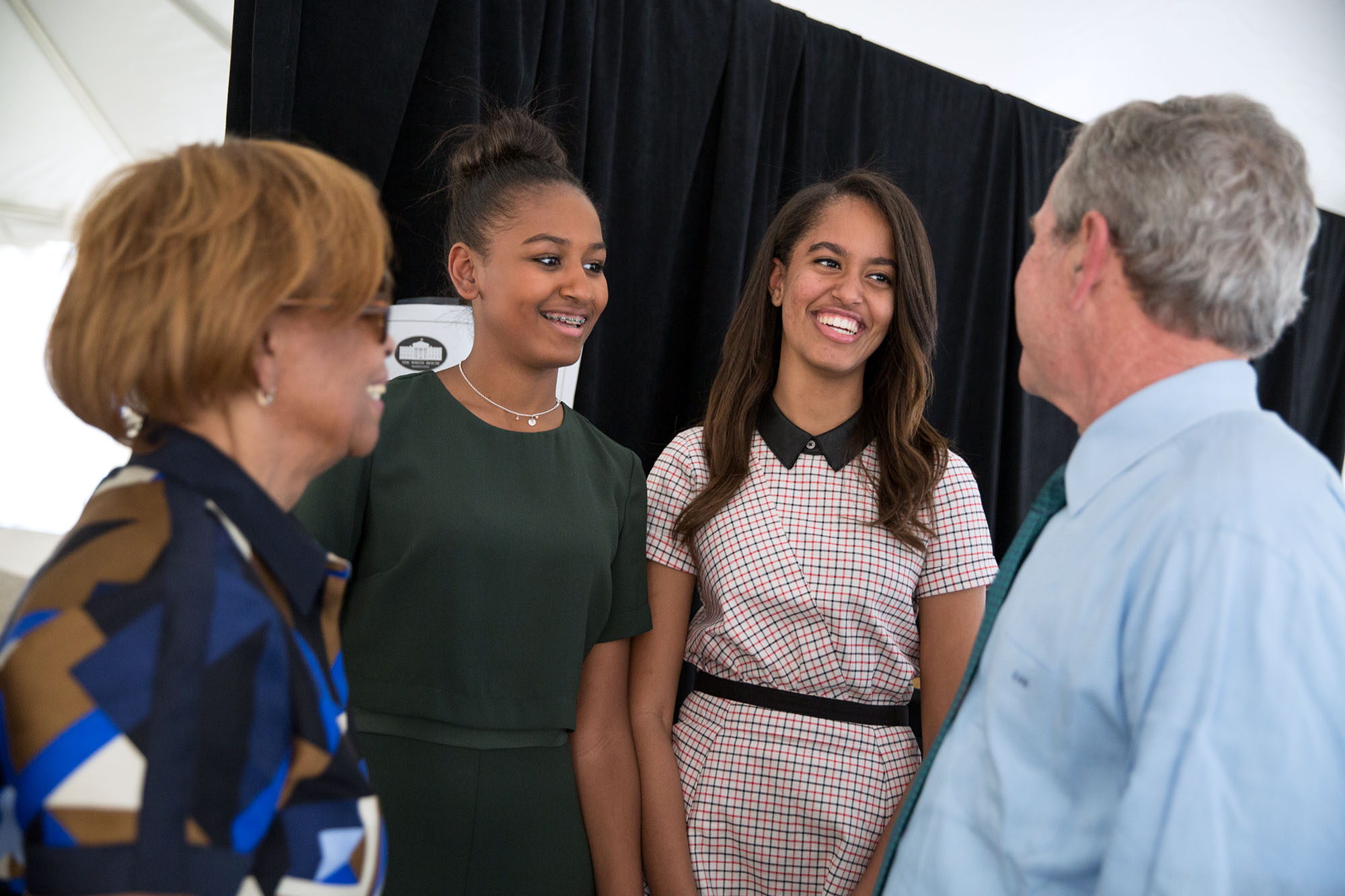 Backstage, former President Bush talks with Sasha and Malia Obama and Marian Robinson. (Official White House Photo by Pete Souza)
