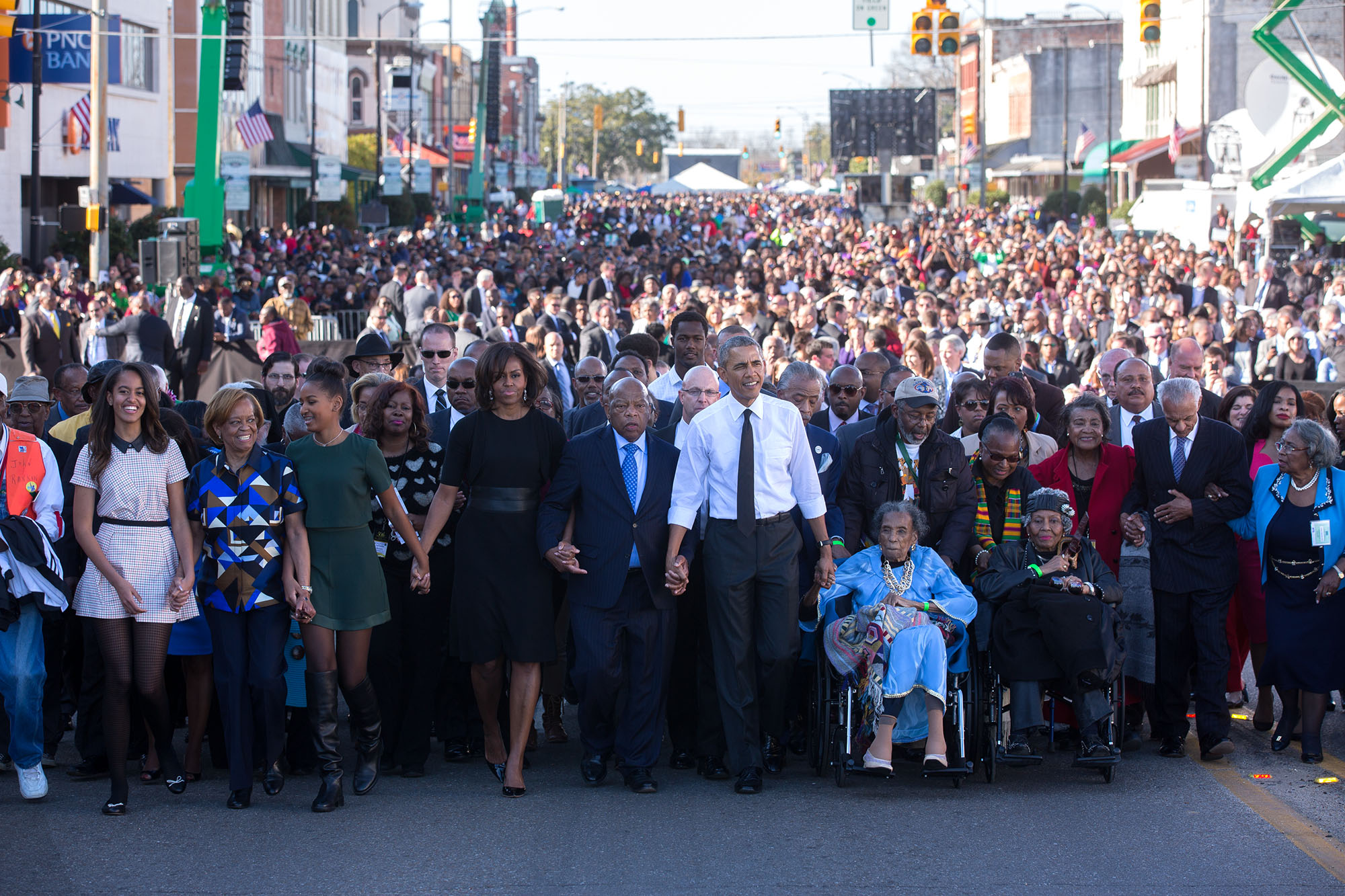 The Obama family marches together in Selma, Alabama.