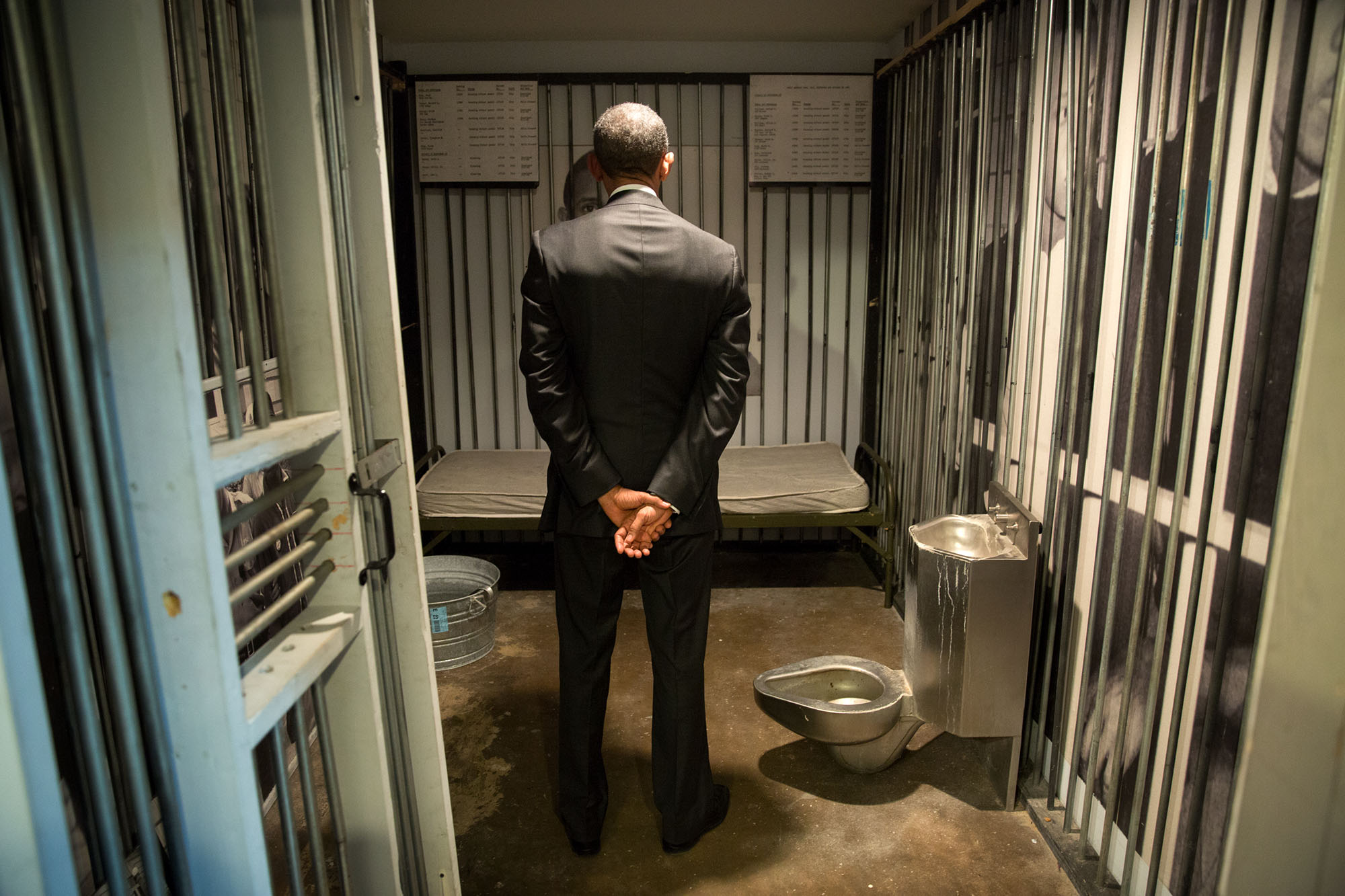 The President stands inside a replica prison cell at the museum. (Official White House Photo by Pete Souza)