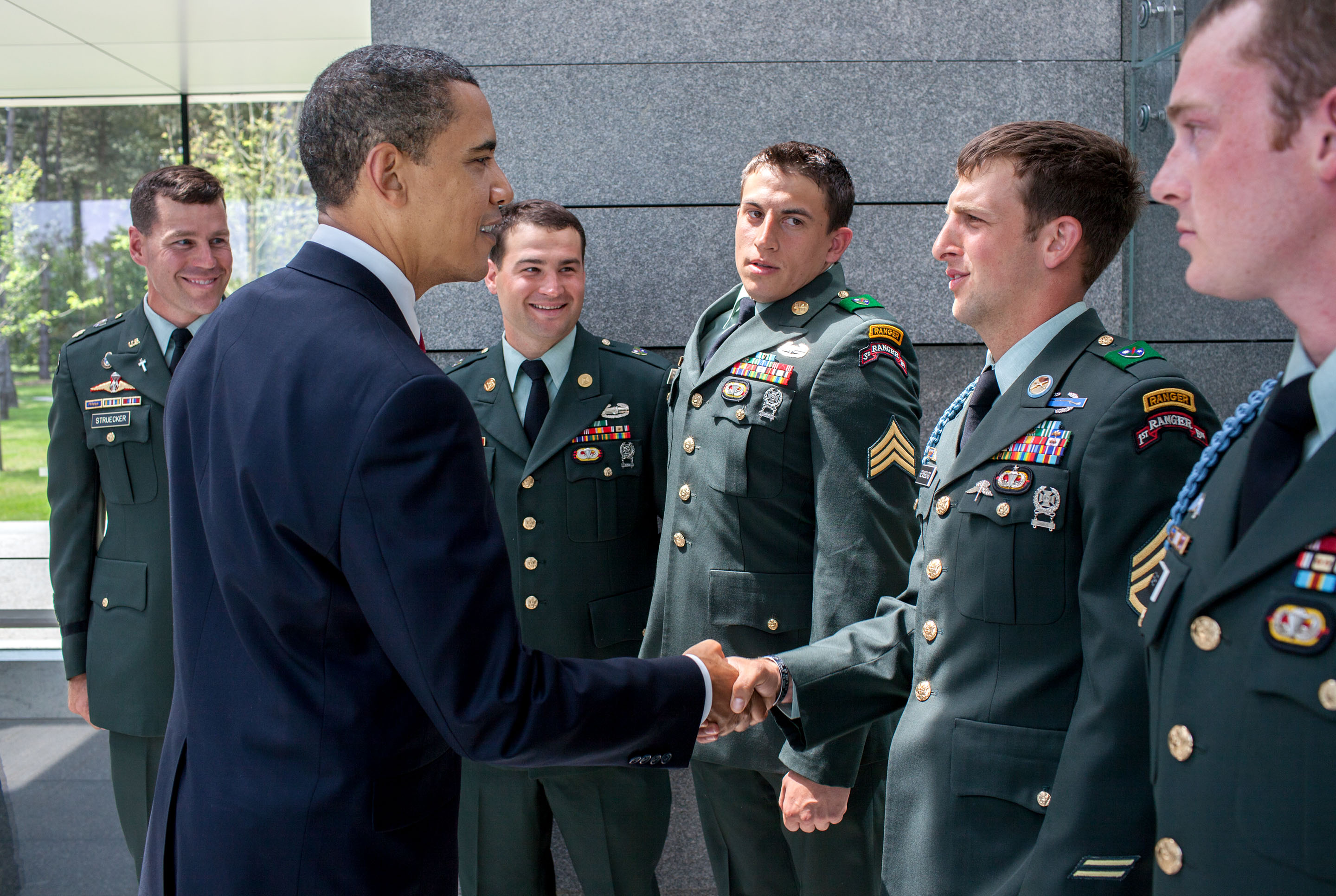 June 6, 2009: President Obama greets Cory Remsburg and other Army Rangers in Normandy. (Official White House Photo by Pete Souza)