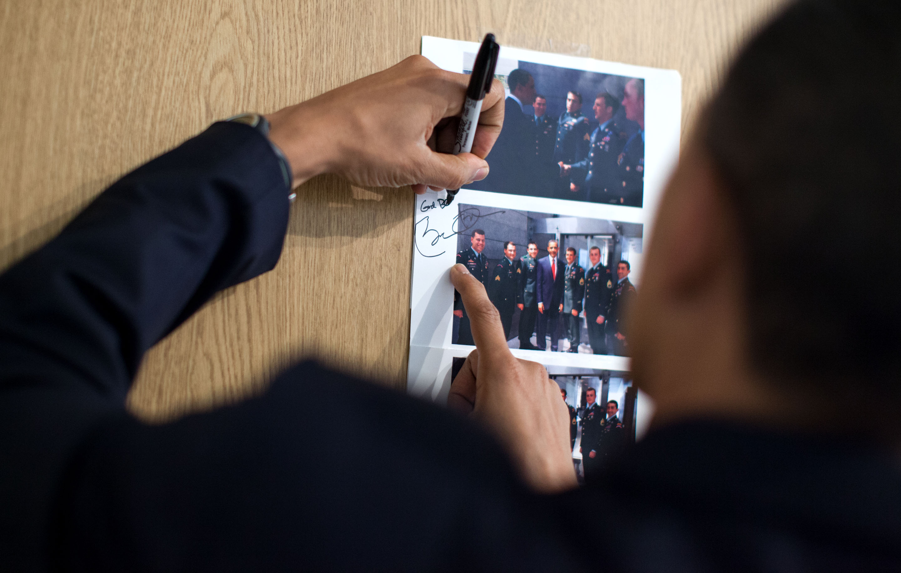 Feb. 28, 2010: The President signs a photo for Cory from their Normandy greeting. (Official White House Photo by Pete Souza)
