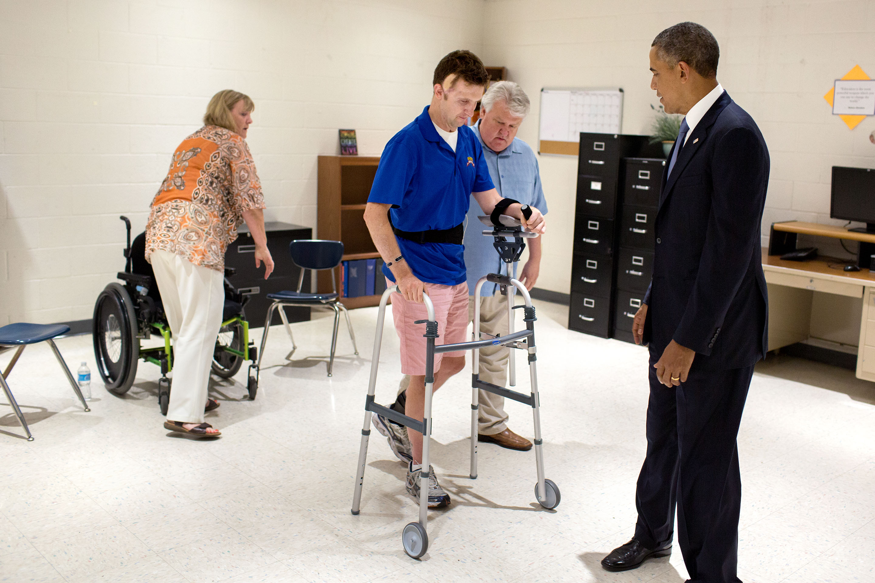 Aug. 6, 2013: Cory walks across a classroom as the President watches in Arizona. (Official White House Photo by Pete Souza)