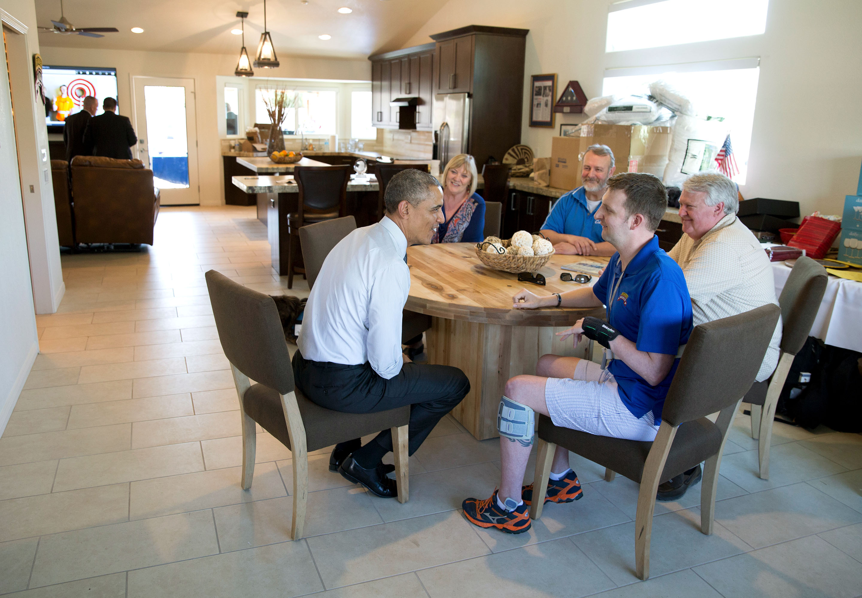 March 13, 2015: President Obama visits with Cory and his family at the kitchen table. (Official White House Photo by Pete Souza)