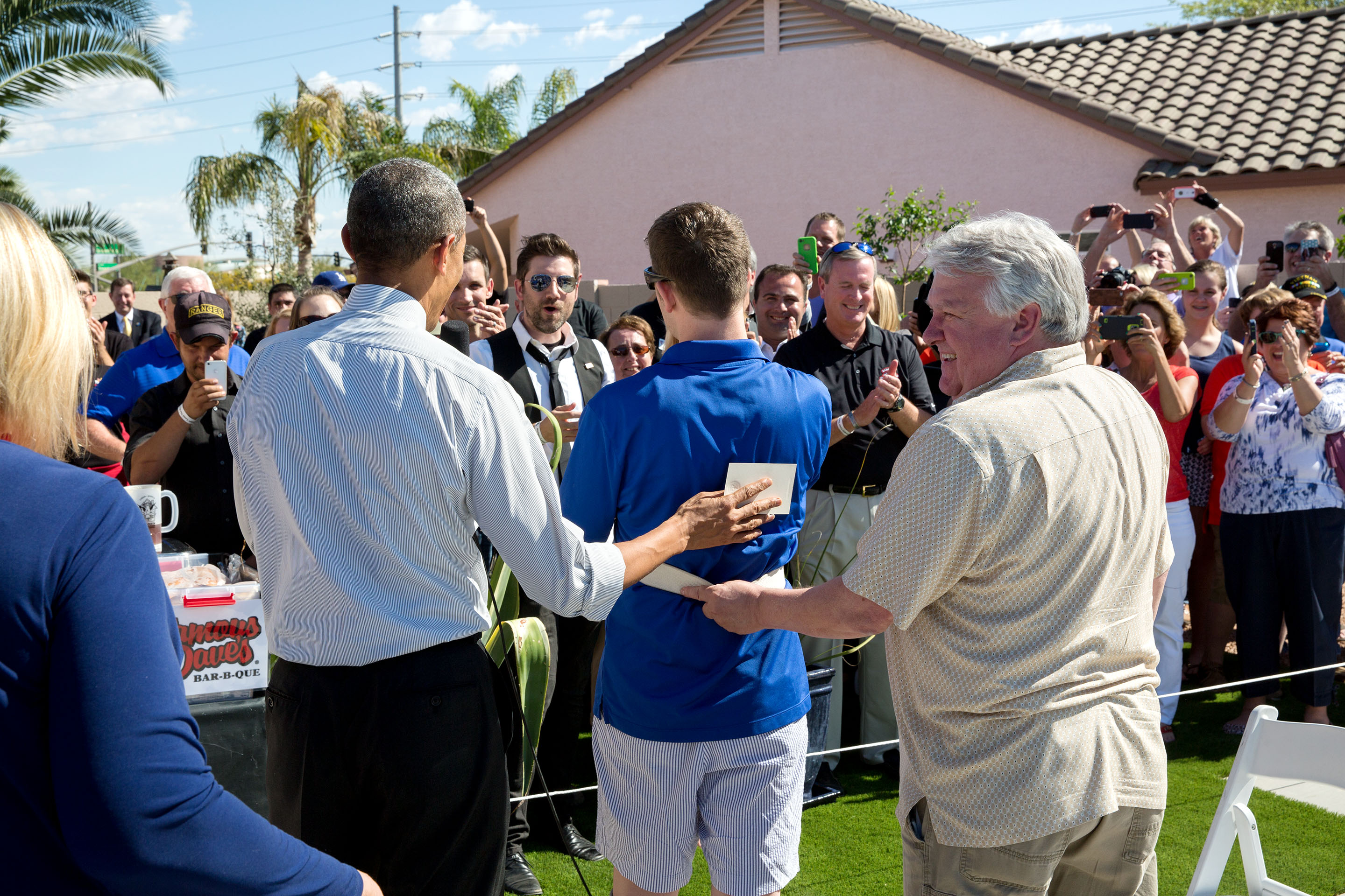 March 13, 2015: The President, Cory and his father Craig greet neighbors, volunteers and donors in the backyard of his home, which was purchased by the Army Ranger Lead the Way Fund and renovated with the help of Jared Allen's Homes for Wounded Warriors. (Official White House Photo by Pete Souza)