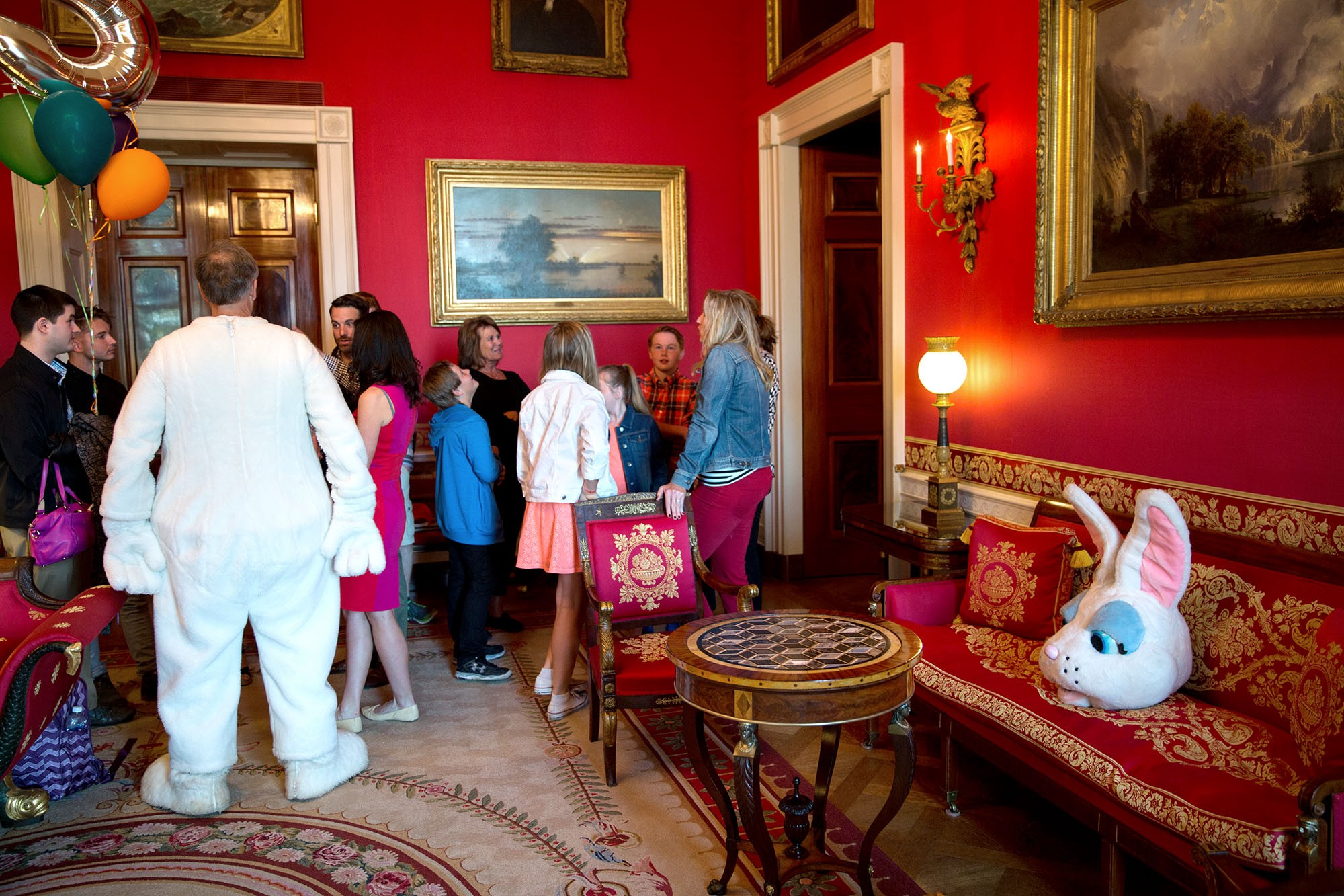 The Easter Bunny joins guests in the Red Room prior to the annual Easter Egg Roll on the South Lawn of the White House, April 6, 2015. (Official White House Photo by Pete Souza)