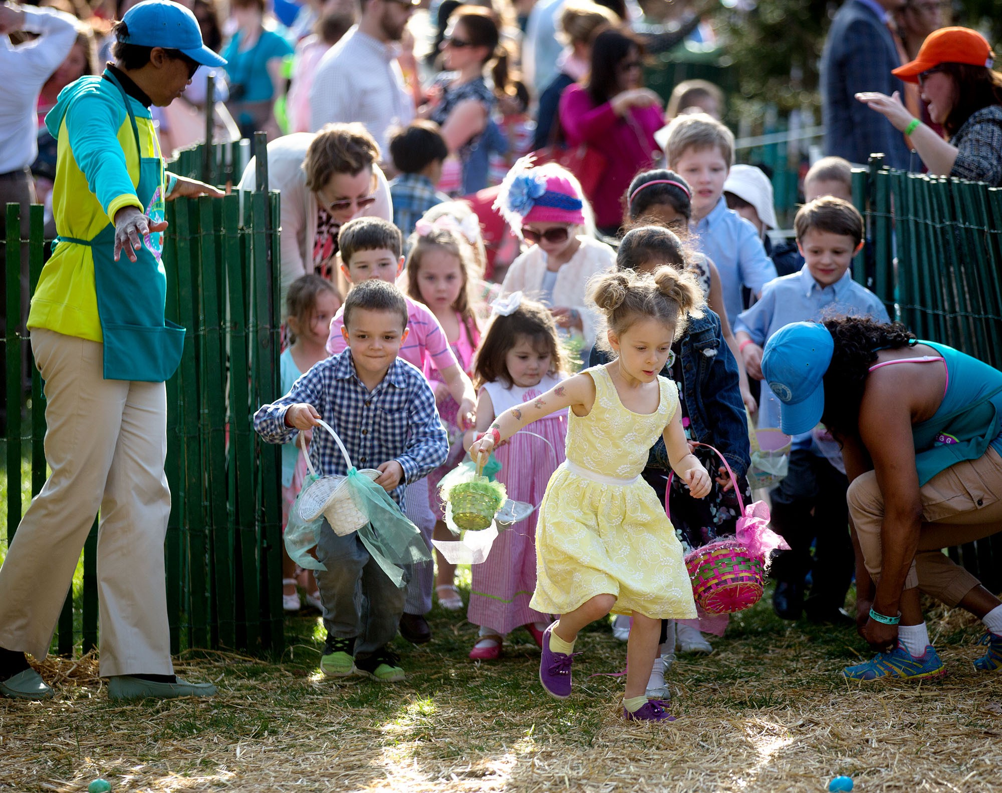 Children rush through the open gate in search of eggs. (Official White House Photo by Lawrence Jackson)