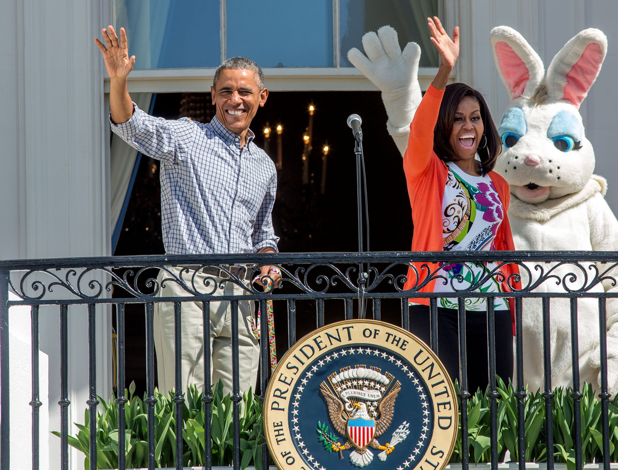 The President and First Lady, with the Easter Bunny, wave from the Blue Room Balcony. (Official White House Photo by David Lienemann)
