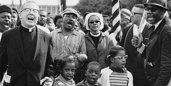 Dr. and Mrs. Martin Luther King, and children marching from Selma to Montgomery