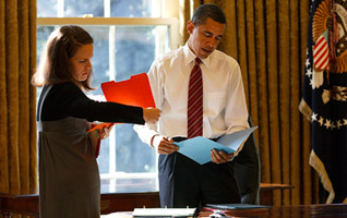 President Obama and his Personal Aide review his daily calendar