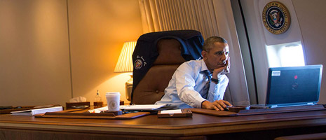 President Obama at his desk working on a computer