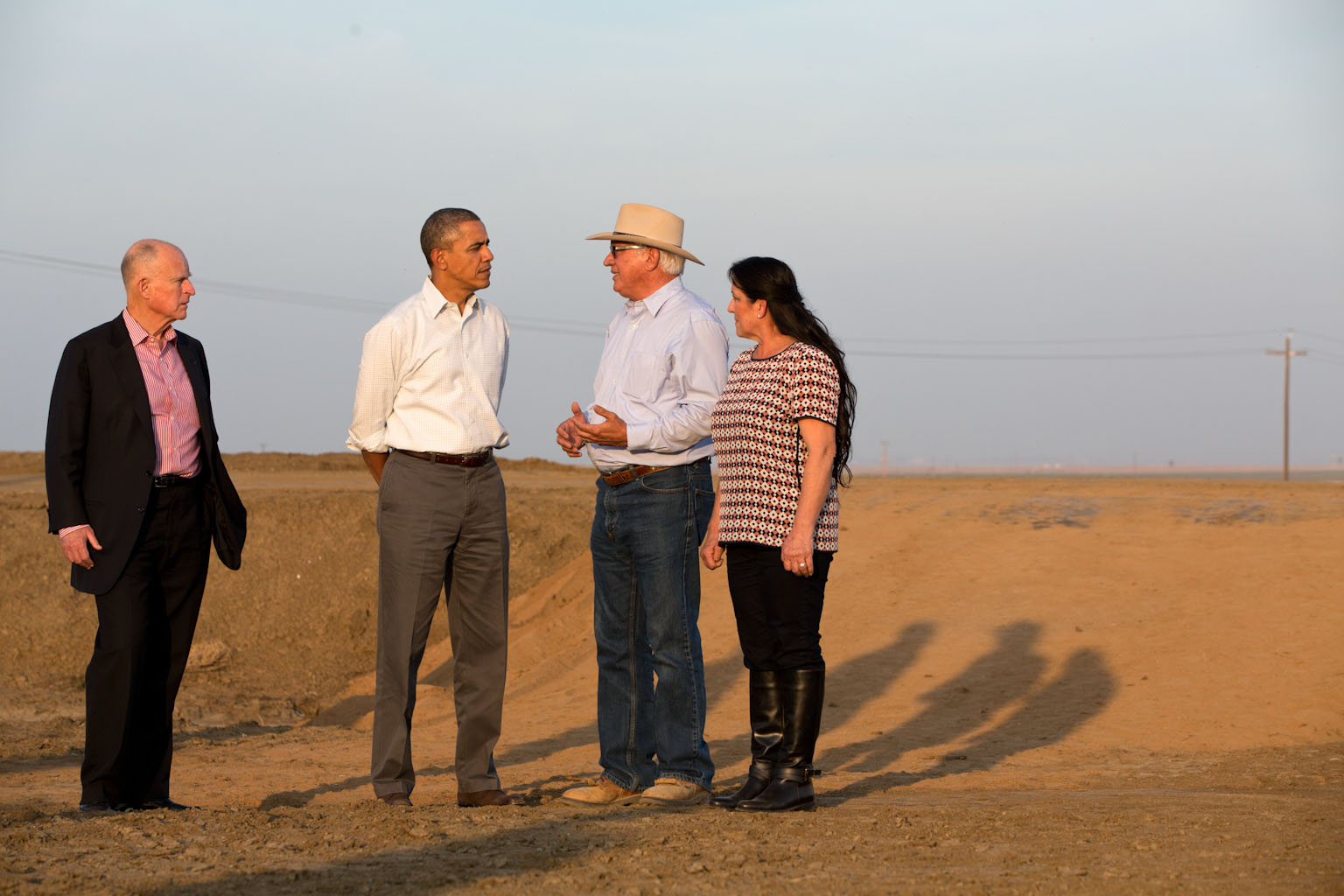 President Barack Obama tours a field with farmer Joe Del Bosque, his wife Maria, and California Gov. Jerry Brown in Los Banos, Calif., Feb. 14, 2014.