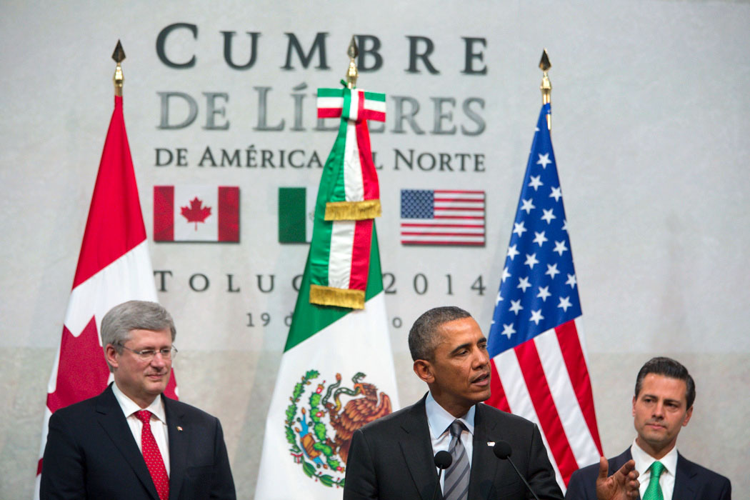 President Barack Obama delivers remarks alongside of President Enrique Peña Nieto and Prime Minister Stephen Harper during the North American Business, Civil Society and Education leaders during the North American Leaders Summit in Toluca, Mexico.