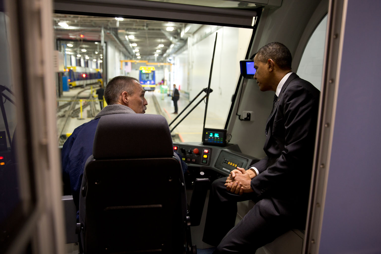 President Barack Obama sits in the cab and talks with a worker during a tour of the Light Rail Maintenance Building in St. Paul, Minn., Feb. 26, 2014.