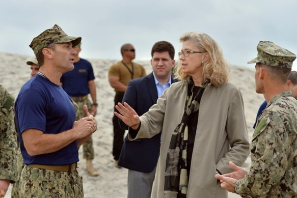 Acting Deputy Secretary of Defense Christine Fox is briefed by Master Chief Paul Baden (USN), as she tours SEAL Beach at the Navy Special Warfare Center in San Diego, Ca., Feb. 10, 2014.