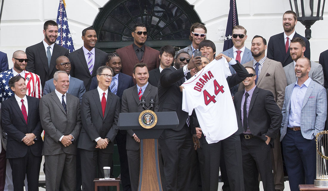 David Ortiz takes a selfie with President Barack Obama as the team presents a jersey during an event to welcome the Boston Red Sox to the White House to honor the team and their 2013 World Series Championship, on the South Lawn of the White House.