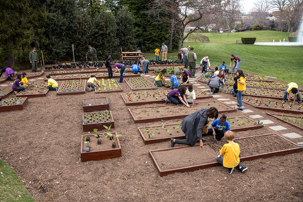 First Lady Michelle Obama joins FoodCorps leaders and local students for the spring garden planting in the White House Kitchen Garden, April 2, 2014.