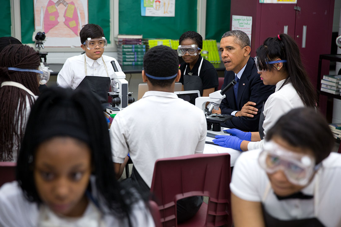 President Barack Obama meets with students working in a biomedical sciences classroom at Bladensburg High School in Bladensburg, Maryland, April 7, 2014.