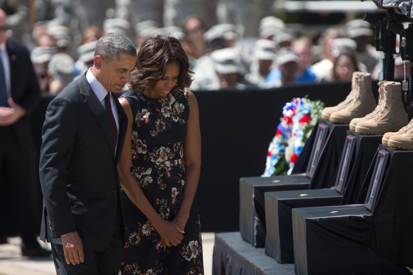 President Barack Obama and First Lady Michelle Obama depart after the President placed a coin on each of the three boxes for those who died, during a memorial service for the victims of the Fort Hood shootings.