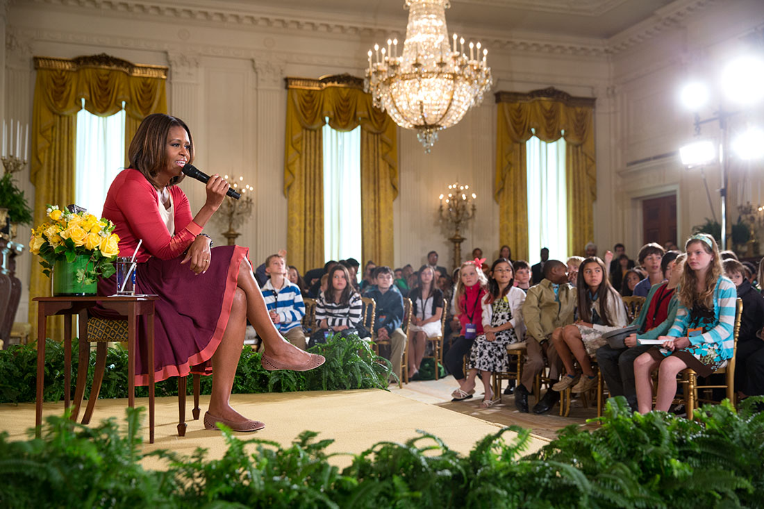 First Lady Michelle Obama answers questions from children at the White House's annual Take Our Daughters and Sons to Work Day, in the East Room of the White House, April 24, 2014.