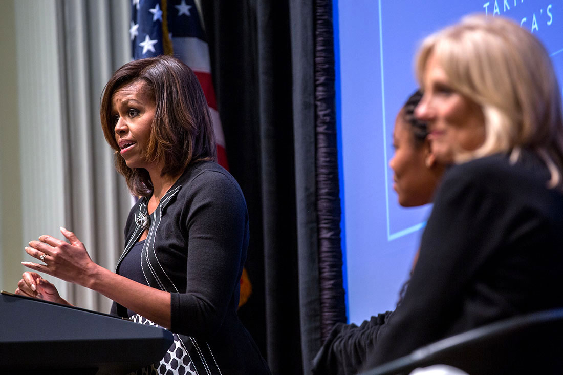 First Lady Michelle Obama, with Dr. Jill Biden and introducer Chrissandra Jackson, delivers remarks during a Joining Forces event at the American Red Cross in Washington, D.C., April 30, 2014.